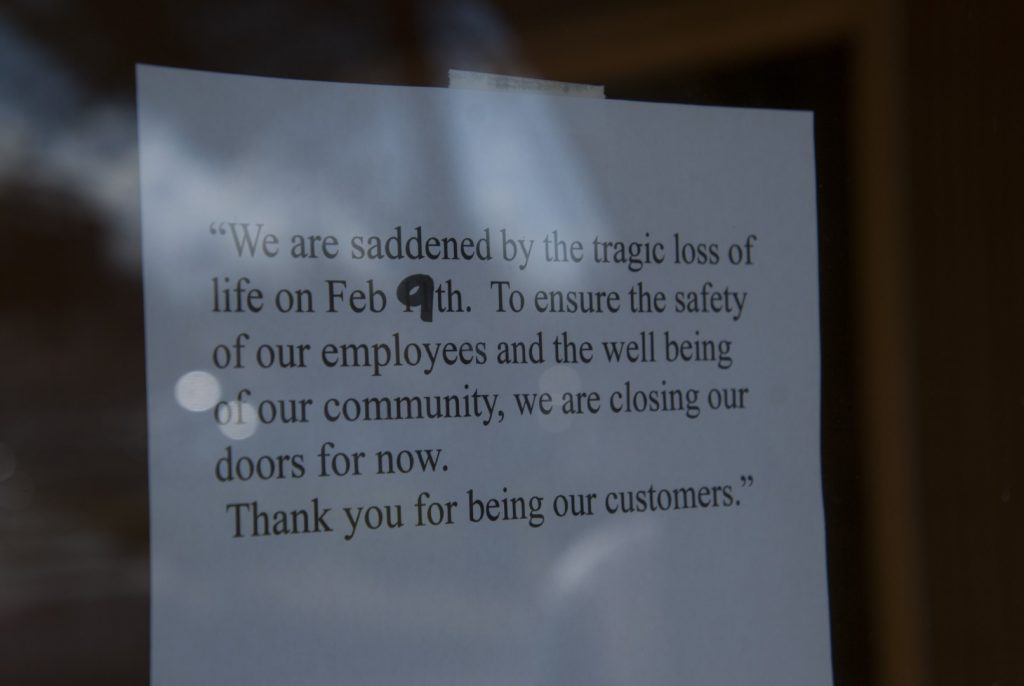 A sign hung on the door indicating that a Taco Bell in Vallejo, California, remains closed after police fatally shot 20-year-old rapper Willie McCoy on Feb. 9.