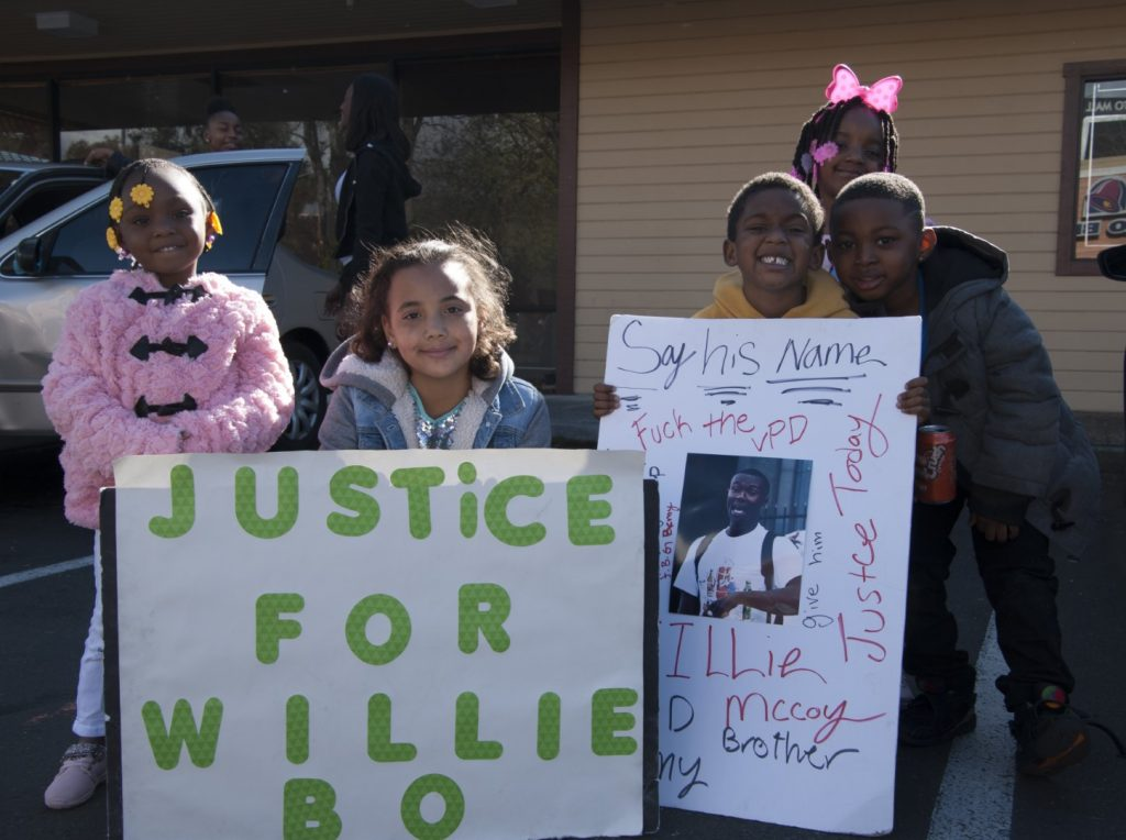 Nieces and nephews of Willie McCoy protest outside a Taco Bell in Vallejo, California, where police fatally shot McCoy, 20, on Feb. 9.