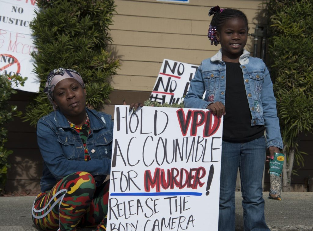 Shontell Vinson and her daughter Erica protest outside a Taco Bell in Vallejo, California, where police fatally shot 20-year-old rapper Willie McCoy on Feb. 9.